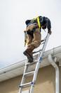 mynt solar installer climbing a ladder t