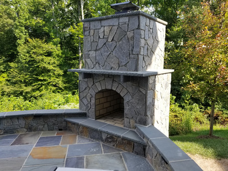 Flagstone patio with an outdoor fireplace in Dumfries-VA.