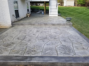 Stamped concrete patio with a dark gray border.