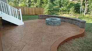 stamped concrete patio, patio, concrete, patio, stamped concrete, decorative concrete, seating wall, firepit, decking, deck, landing, trex