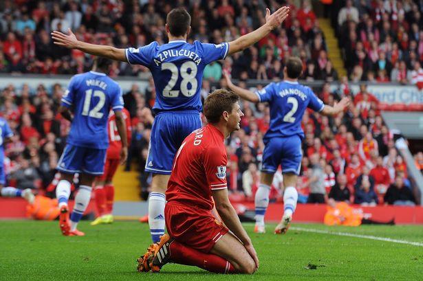 Steven Gerrard looks on dejectedly following Demba Ba's winnning goal.