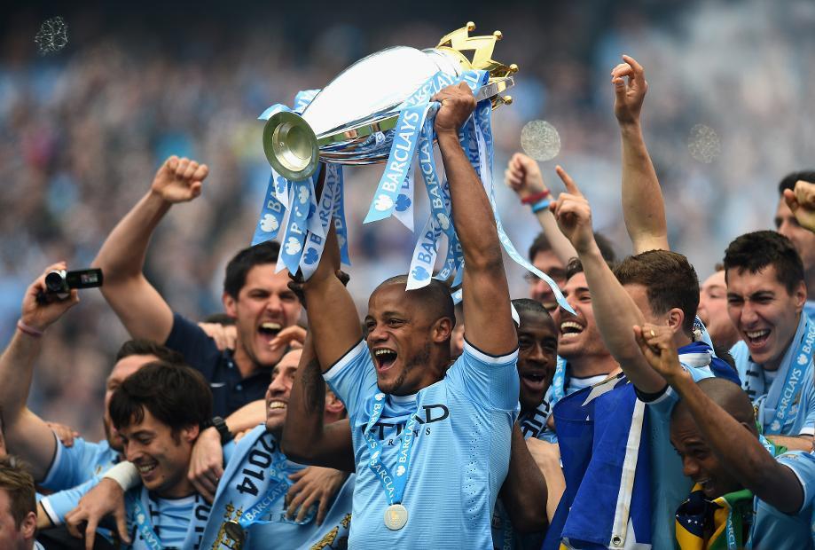Manchester City lift the 2019 Premier League Trophy.