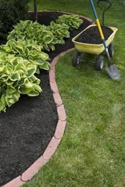 mulching flower beds weed pulling planti