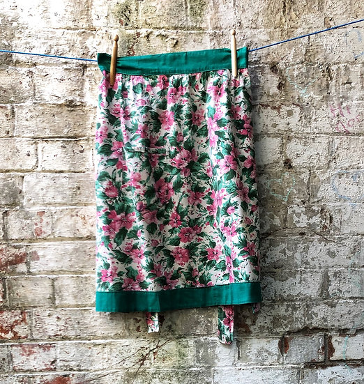 green and pink floral apron