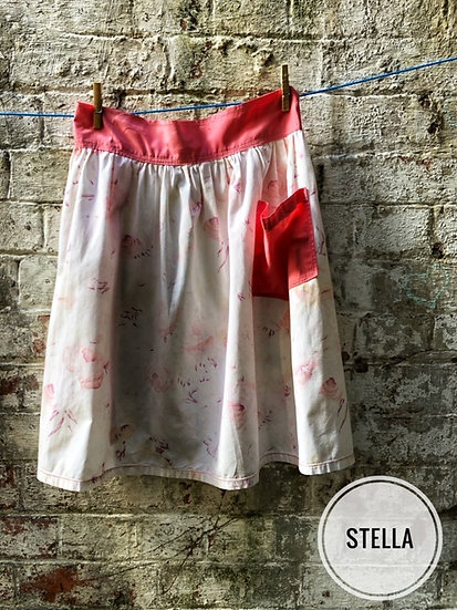 white floral print vintage apron with pink pocket and trim