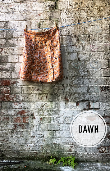 a orange and white print vintage apron in a panelled style