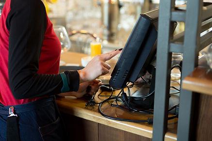 waiter-modern-cafe-bar-enters-order-paym