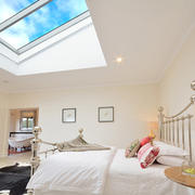 Apartments- bedroom, bed, skylight- web.