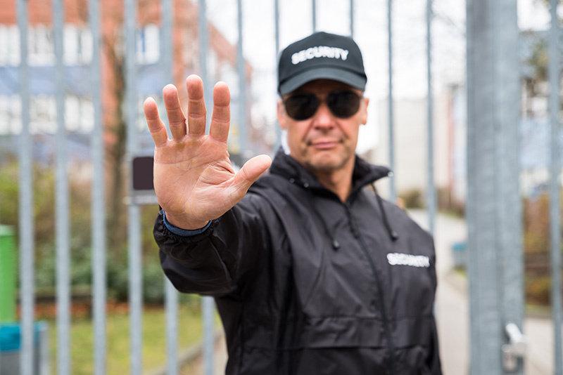 security-guard-making-stop-gesture.jpg