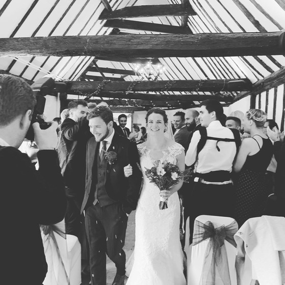 Happy couple leaving Rafters Barn