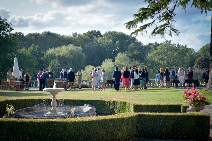 Wedding guests on lawn by Great Lake at