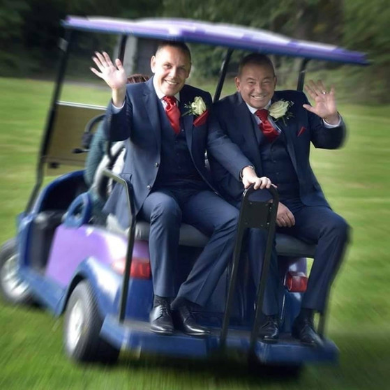 Happy couple hitching a ride on our golf buggy