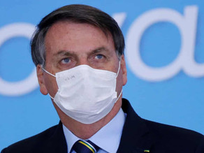 Brazilian judge tells Bolsonaro to behave and wear a face mask