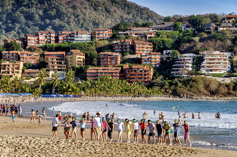 tourists on beach in ixtapa