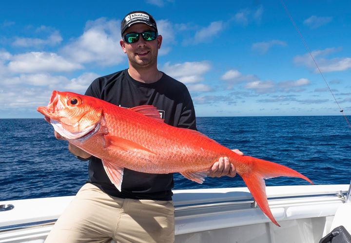 Jay Harris from Mustad Hooks with a solid Queen Snapper aboard the Get Bent