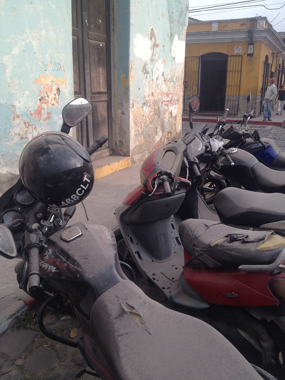 volcanic ash covering the streets and motorbikes of Antigua, Guatemala (Photo by John Early)