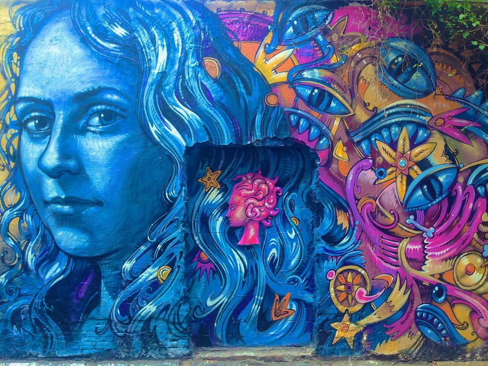 Blue woman graffiti in Berlin