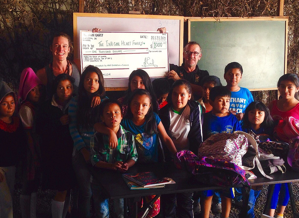 John Early Author big cheque donation to Integral Heart Family Foundation in Antigua, Guatemala