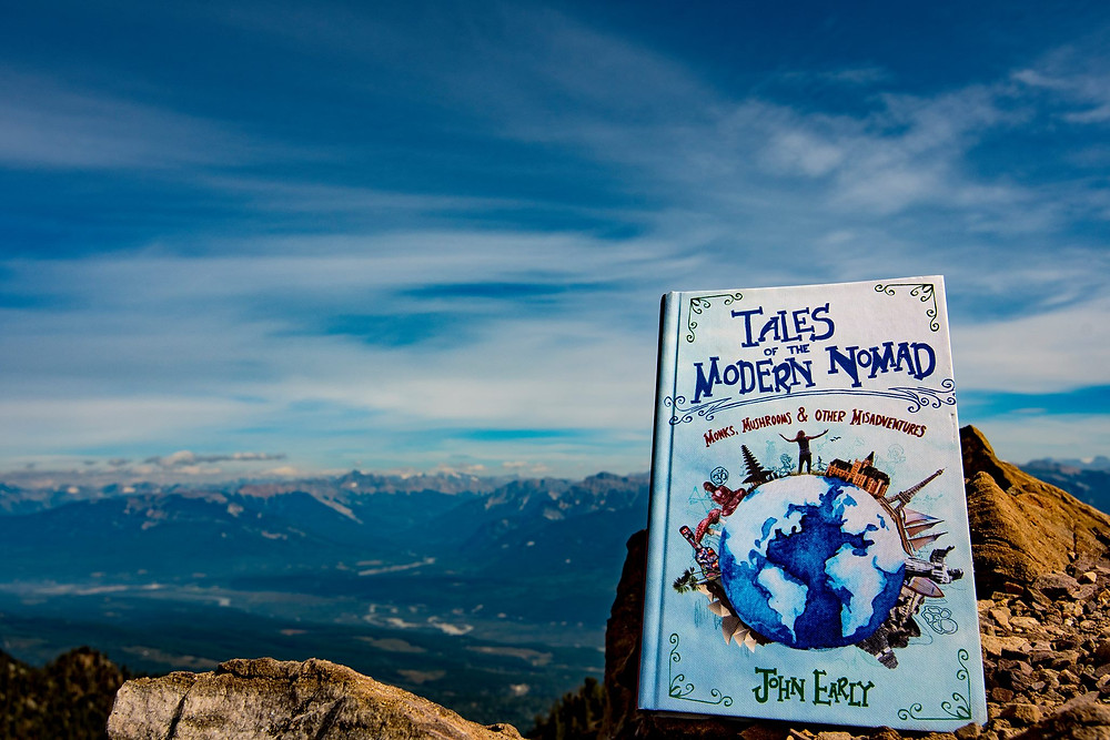 Tales of the Modern Nomad book cover on top of Terminator 2 hike, Golden BC, Canada (Photo by Mountain Man Cole)