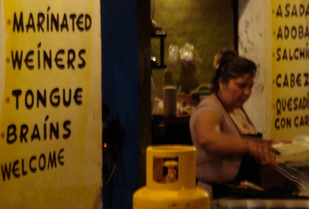 crazy menu at a mexican taco stand. Brains, tongue, welcome! (Photo by John Early)
