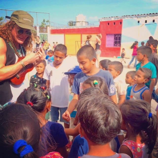 Author John Early playing ukulele with Momentom Collective Social Circus at Casa de Los Suenos Education Plus Granada Nicaragua