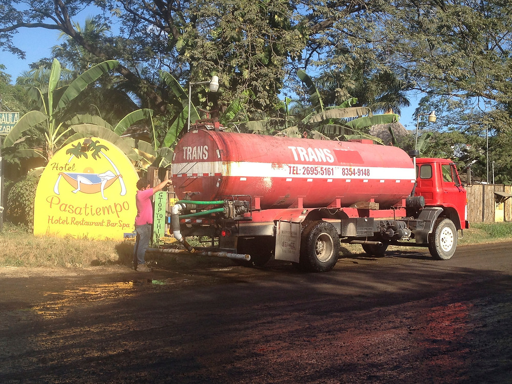 the molasses truck spraying the streets in tamarindo, costa rica (Photo by John Early)