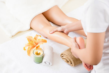 Professional therapist giving oil massag
