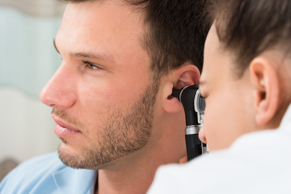 NEW dr examining mans ear.jpg