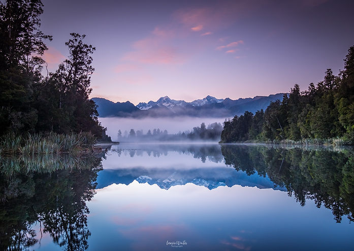 Perfect sunrise reflections at Lake Matheson near Fox Glacier in New Zealand. Photographyby Laurie Winter