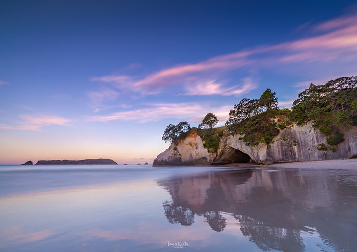 Sunset at Cathedral Cove beach in the Coromandel. Photo by Laurie Winter.