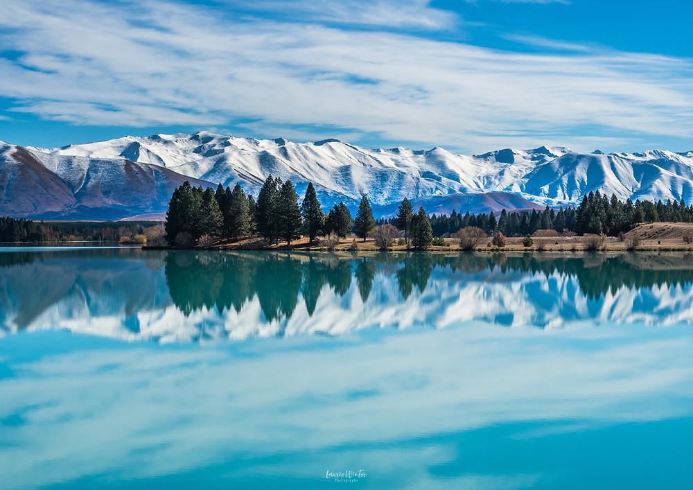 Lake Ruataniwha reflections snow blue sky trees Twizel