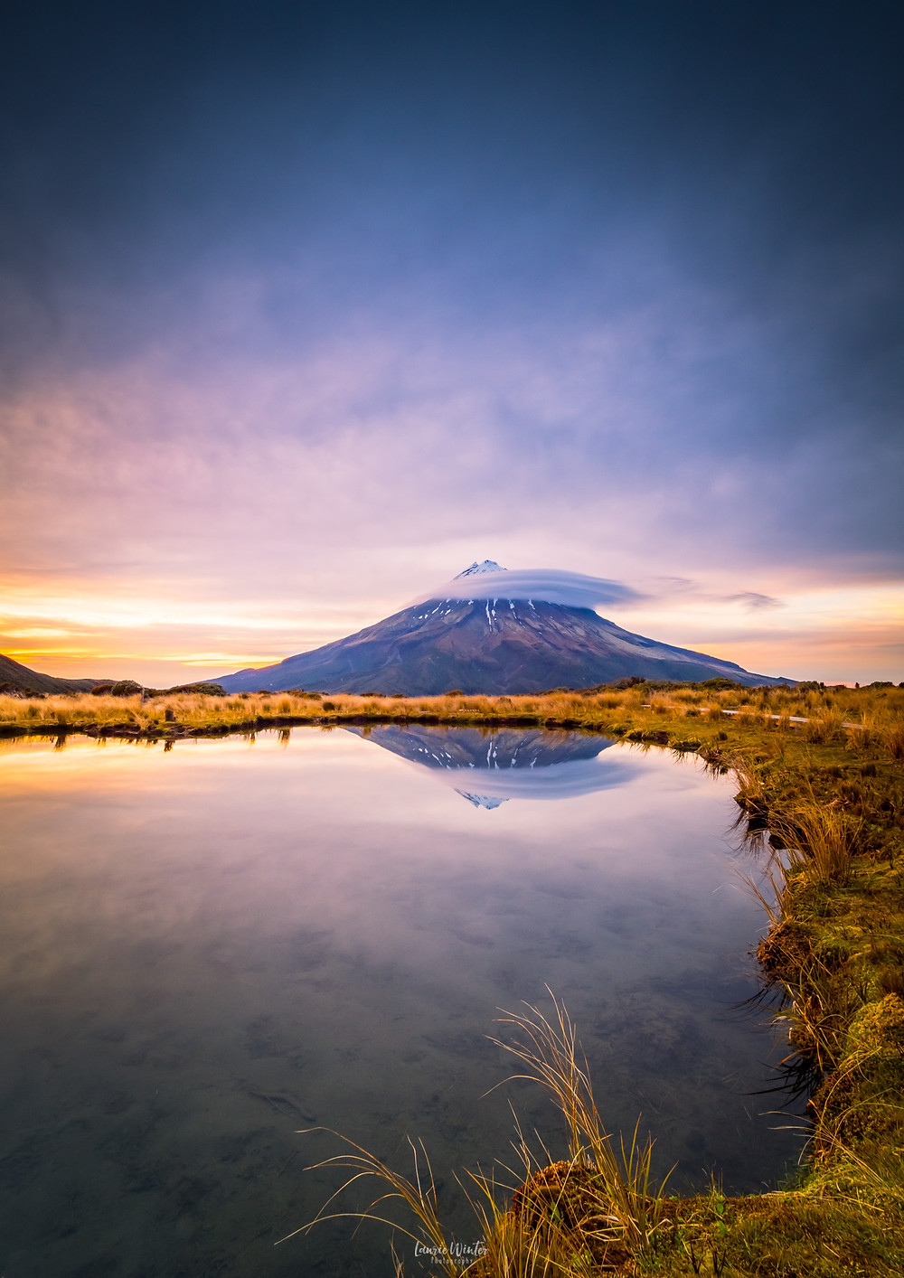Sunrise with Mt Taranaki reflection in Pouakai Tarn beautiful