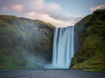 Sunrise at Skógafoss, an enormous 60m waterfall in Iceland