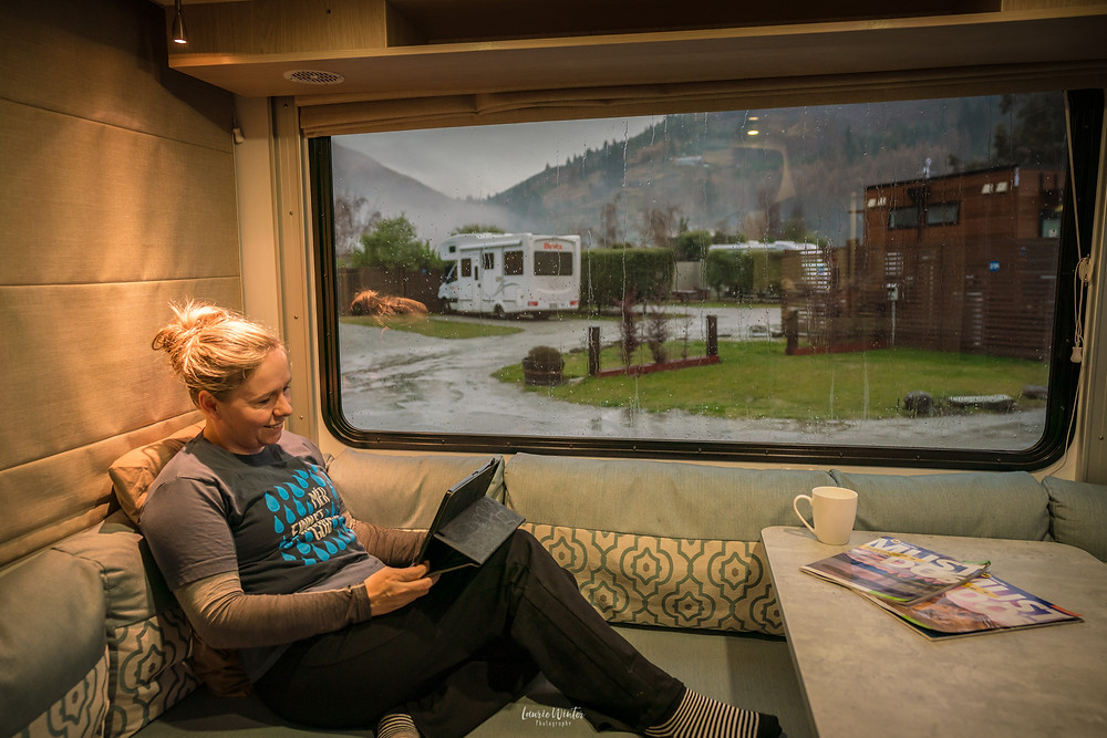Reading in the back of the motorhome on a rainy afternoon in Queenstown