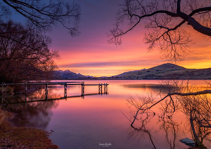 A beautiful Queenstown sunset at the Lake Hayes jetty. New Zealand photography by Laurie Winter.