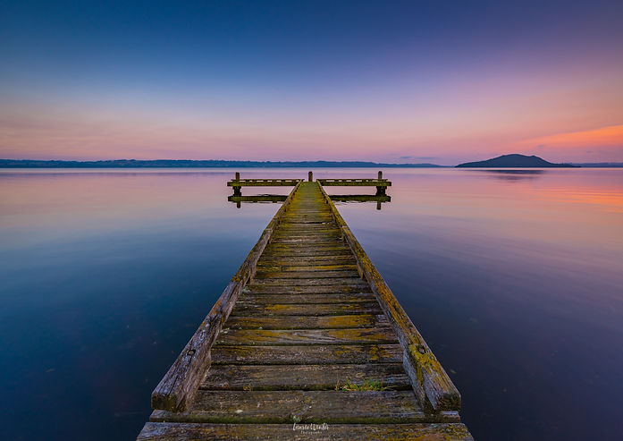 A still morning sunrise at Kawaha Point jetty on Lake Rotorua. New Zealand photography by Laurie Winter.
