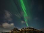 Aurora over Kirkjufellsfoss in Iceland