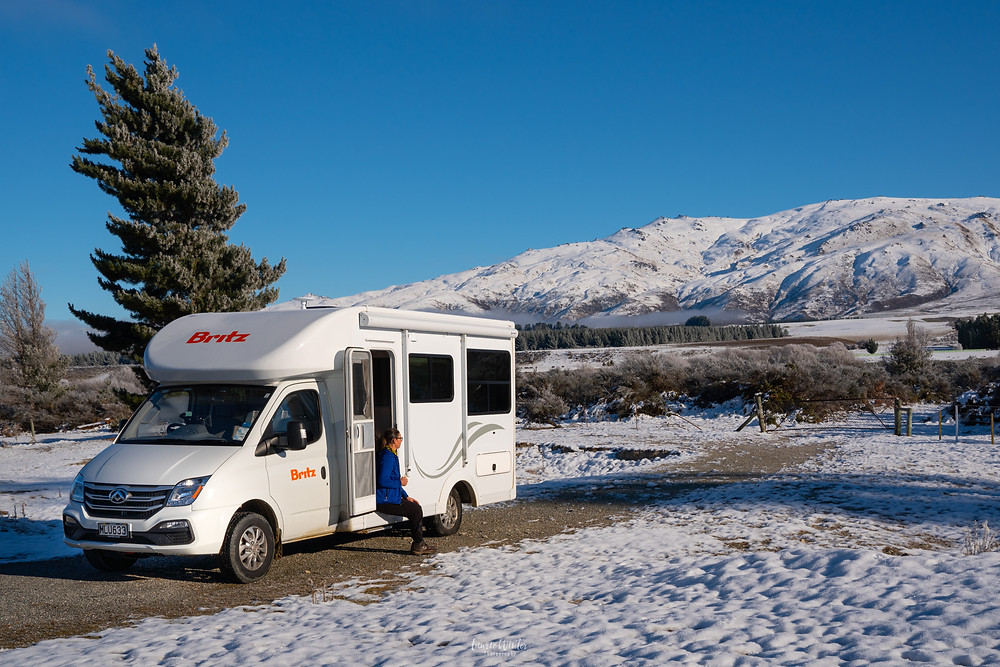 Campervan parked in the snow near St Bathans in Otago