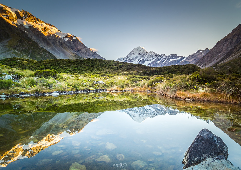 Mt Cook mountain tarn reflections on beautiful day New Zealand