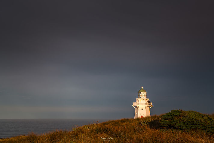 A stormy day at the Waipapa Point Lighthouse in the Catlins, New Zealand. Photography by Laurie Winter.