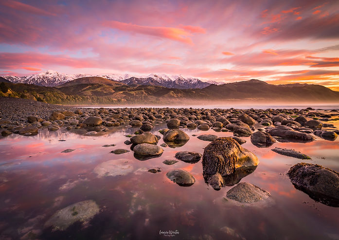 Beautiful sunrise in Kaikoura, New Zealand, near Maungamaunu Beach. Photography by Laurie Winter