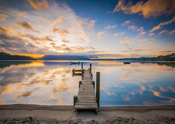 Sunrise at a jetty on Lake Tarawera near Rotorua, New Zealand.