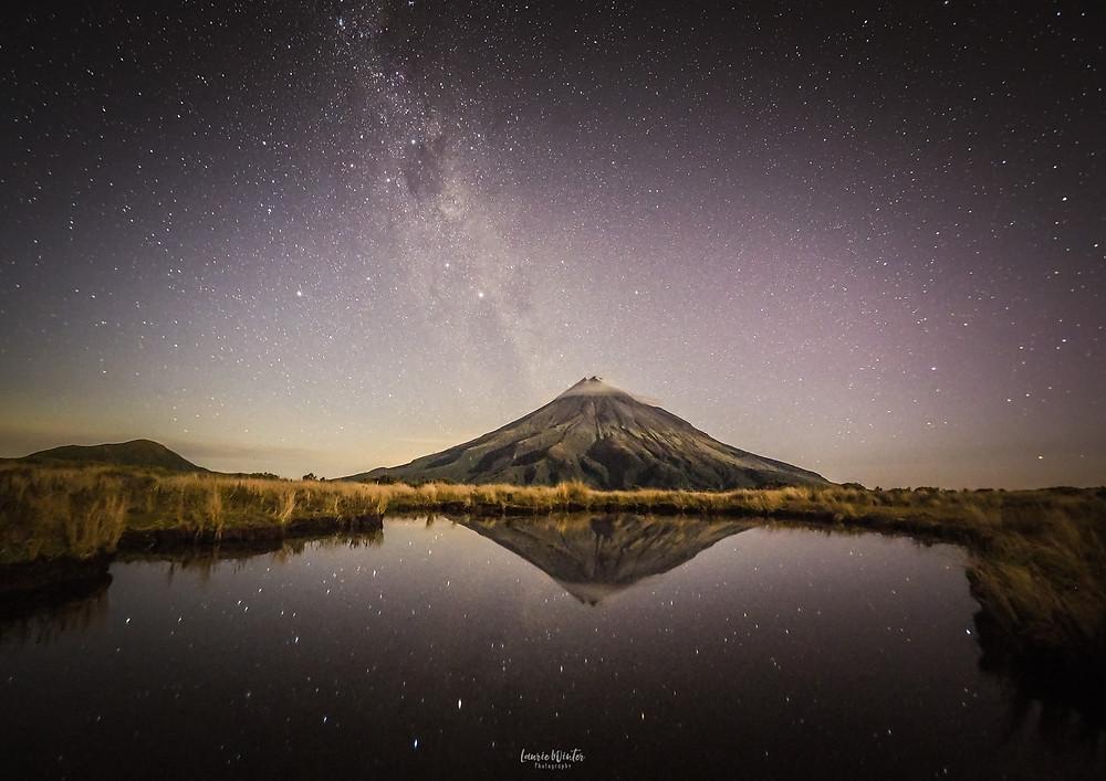 Stars and Milky Way over Mt Taranaki reflection Pouakai Tarn