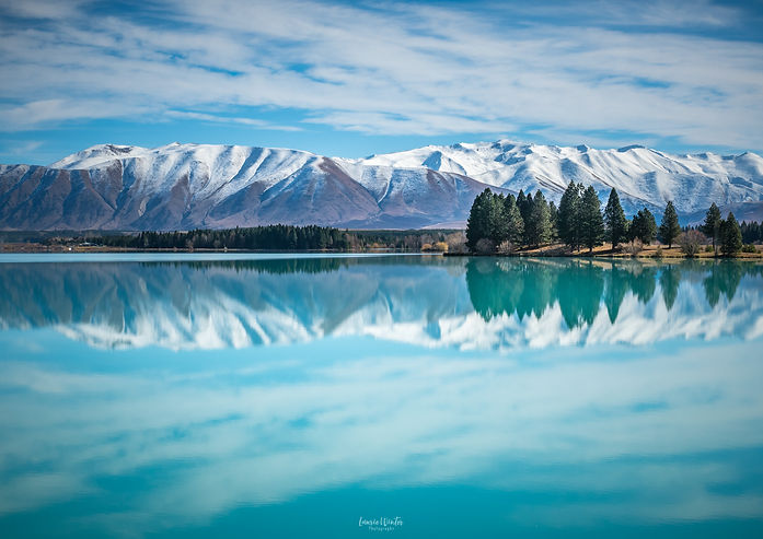 Ben Ohau reflections in Lake Ruataniwha in Twizel, New Zealand. Photography by Laurie Winter.