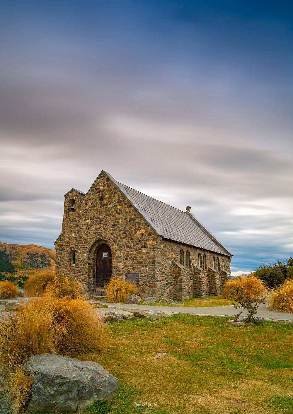 Cloudy skies at Church of the Good Shepherd in Tekapo New Zealand