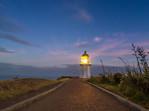 Stars over Cape Reinga Lighthouse at Sunrise