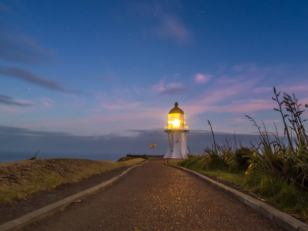 Stars over Cape Reinga Lighthouse at Sunrise