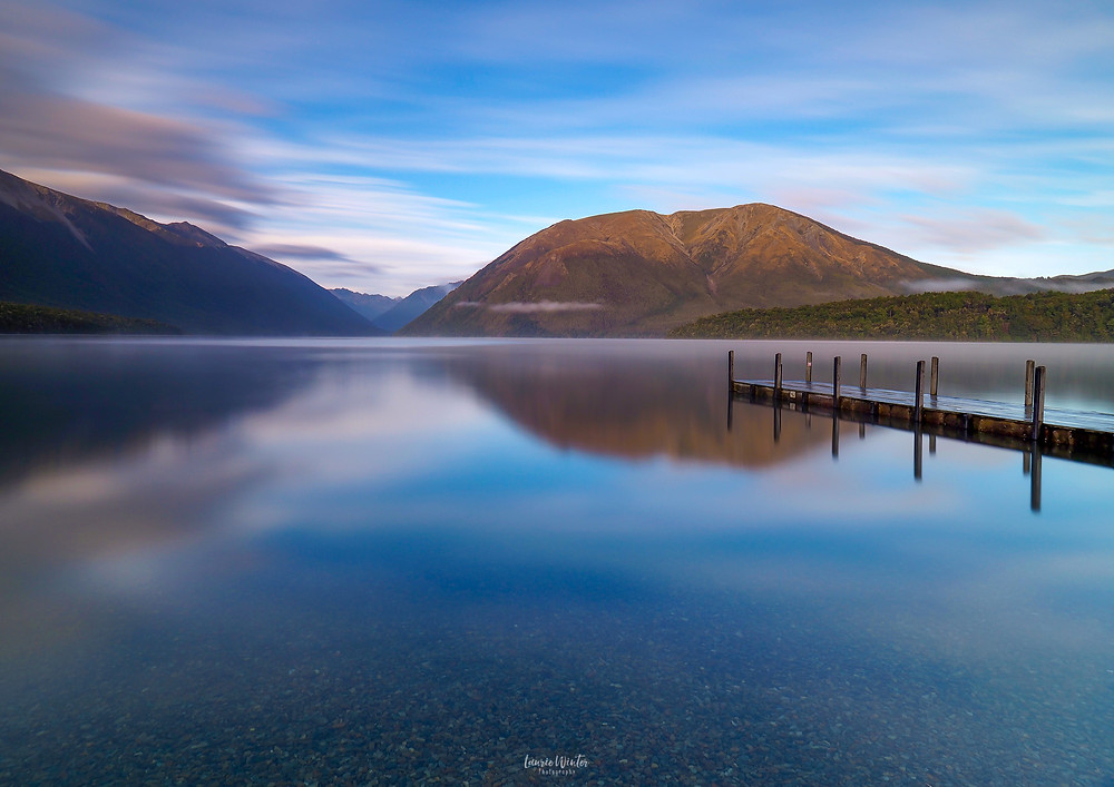 Lake Rotoiti reflections with jetty at sunrise