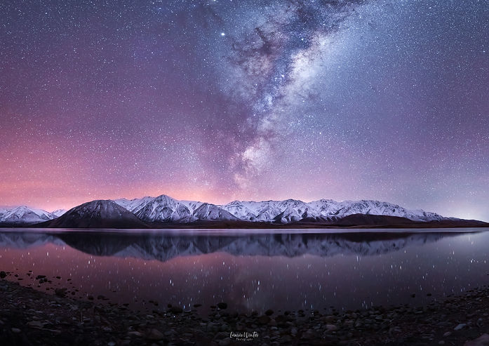 Milky Way astrophotography over the mountains around Lake Heron in the Ashburton Lakes. Photography by Laurie Winter