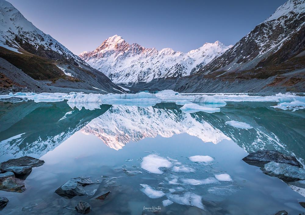 Hooker Lake reflections with icebergs Aoraki Mt Cook National Park